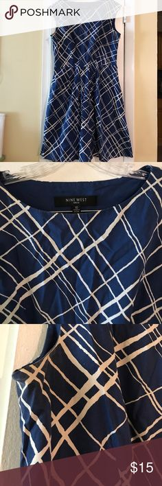 Nine West Beautiful Navy Blue Spring/Summer Dress Beautiful navy blue dress that easily pairs with a nude, white or red heel. Gently used and has minor discoloration underneath the arms. Nine West Dresses Midi