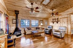 pine paneling and floor and fireplace