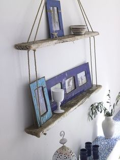 Nautical DIY bookshelves. I assume I'll need 2 weathered boards; I'd like at least 4 inches of depth, and probably 15' of rope (for some added sailor knot embellishments). Of course, a drill, or some other way to make the holes, a wall anchor and probably a tape measure.