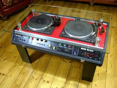 FAL Twin Decks retro Coffee table by Vyconic on Etsy, £610.00    Very funky DJ turntable deck repurposed as a coffee table.