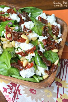 Sicilian Spinach Salad with Fresh Basil vinaigrette...2 c. fresh spinach,  creamy goat cheese, sun dried tomatoes and pine nuts