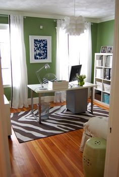 THIS is what I want my office to look like.  Warmer color scheme, more muted tones, but I LOVE the windows, the bookcase, the furniture placement.  yes yes yes.