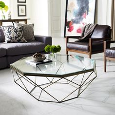 """The simple lines of the Geometric Coffee Table celebrate the negative space with the glamour of sparkling glass and an antiquated brass base. 44""""W x 40.75""""D x 15.5""""H"""