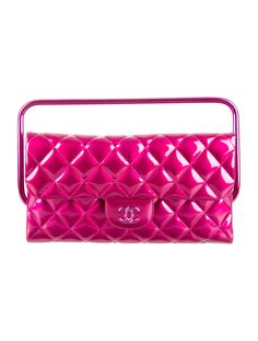 From the Spring/Summer 2014 Collection. Magenta metallic quilted patent calfskin Chanel clutch with tonal hardware, single top handle, dual compartments; one with zip closure, tonal satin lining and flap with magnetic snap closure at front. Serial number reads 19511092. Includes authenticity card, box and dust bag. Shop authentic designer handbags by Chanel at The RealReal.