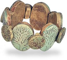 Minnesota's Jan Geisen knows how to make shapes comfortable with each other and just by looking at her Flickr gallery you start to understand how shapes on top of shapes can work harmoniously. On this bracelet overlapping circles are cleverly constructed on bases that snuggle between larger