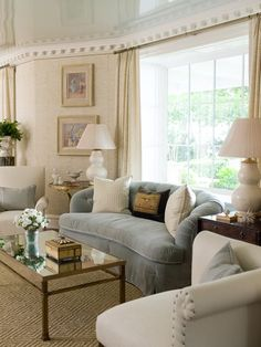 phoebe howard   Living Room -  nailhead detail on the walls and chair. Natural fiber rug pattern