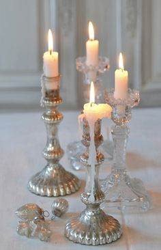 Glass and silver candlesticks