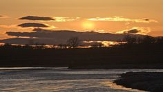The sun sets over the Yellowstone River near South Bridge in Billings on Tuesday.