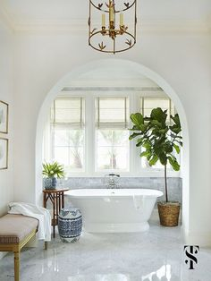 Traditional marble bathroom with porcelain freestanding tub