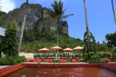 THAILAND (Ao Nang, Krabi) - Ao Nang Paradise Resort - We got to stay here because our taxi driver dropped us here after a full day of traveling. So were were a bit sceptic at first, but soon we found out that the taxi driver exactly felt what we needed: a very affordable hotel with deluxe bungalows, a very refreshing swimming pool where you can buy the most delicious food. Plus the views around the resort are like something out of a movie.