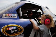 The groupies are getting younger everyday... :)   NASCAR Sprint Cup Pictures - CBSSports.com