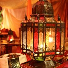 I like Indian themed rooms but I sometimes think all the color would be overwhelming. I love lanterns and stained glass so this piece makes me think i could deal with such a busy room.
