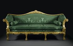 Sofa or settee, giltwood with serpentine back centred on a stylised palm flower issuing scrolls and husks, upholstered back, arms and seat, designed and made for John Spencer, later 1st Earl Spencer, for the Palm Room at Spencer House, St James's Place, London: British, London, probably designed by John Vardy, probably made by John Gordon, c. 1758.