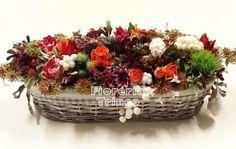 Foto Centrotavola personalizzato rettangolare del fiorista tondo con fiori freschi di stagione