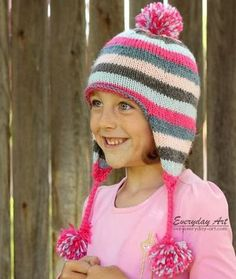 The Veronica Ear Flap Hat is a beautiful addition to a winter wardrobe. The clean stripes and pompom will have any child fall in love with the design. Never lose your child in a crowd, this hat can be seen for miles.