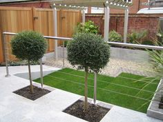 Contemporary Garden Ideas Uk light grey stone and dark deck - good combo/contrast | dream