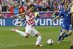 Mandzukic joins Dzagoev and Gomez to lead Euro 2012 scorers.