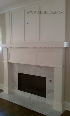 Shaker style surround with marble tile. Substantial looking, I also like the dental trim detail.
