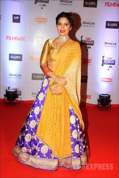 Bhumi Pednekar in a purple and yellow lehenga on the red carpet at the Filmfare Awards show. #Bollywood #Fashion #Style #Beauty #Desi
