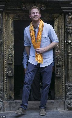 Prince Harry is pictured beaming as he tours the Golden Temple...