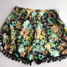 Floral beach shorts Floral beach shorts with fringe! Fit true to size with elastic waist. Length with fringe will hang about mid thigh. Polyester Shorts
