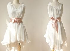 Too cute! Hi-low white dress with a simple bow around the waist.