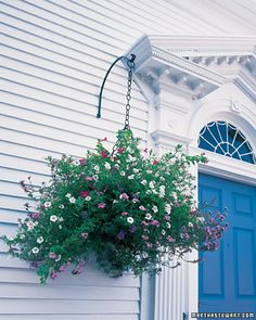 Graceful plantings add color and whimsy to this home's dramatic entrance without…