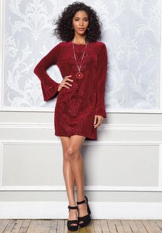 Get ready for a night out on the town in this lavish shift dress, featuring brilliant bell sleeves and a velvet burnout fabrication. #catofashions