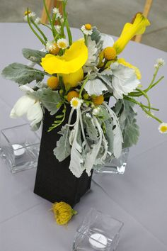 yellow and gray flower arrangement ideas! With dusty miller leaves