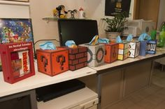 Geeky Tissue Boxes - Throw out your flowery Kleenex boxes and reach for a tissue from a pixelated Super Mario Brothers cube or from the delightful companion cube with this geeky tissue boxes. These clever boxes will are the perfect gift or DIY idea for a gamer's home.