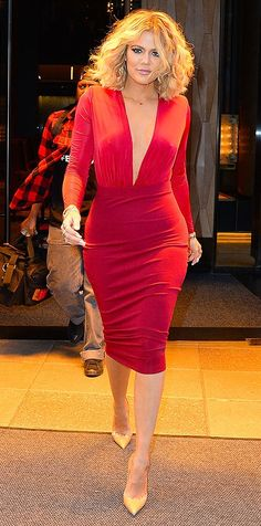 Khloe Kardashian, here in a sexy red Jluxlabel dress and heels, explains why she got her short lob haircut