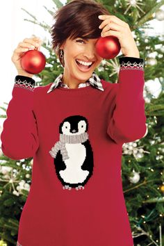Finish a festive look with this perky pullover penguin sweater. It's sweet, seasonal, and oh-so-soft, perfect for pairing with anything from a solid skirt to your favorite jeans.