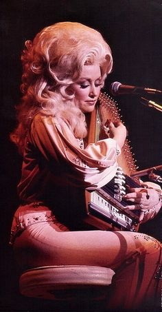 I want some of what Dolly hair was smokin' cause that hair is HIGH.....