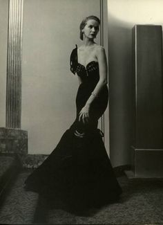 1940s evening gown, love the placement of her left arm, the slight bend of her waste as she leans on the wall