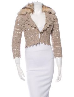 """Fox-Trimmed Cashmere Cardigan Beige Carolina Herrera crocheted cashmere cropped cardigan with detachable fox fur collar, scalloped hems throughout and front button closure. Color: Brown Size: S Estimated Retail: $3,290.00 Condition: Pristine Fabric: 100% Cashmere Measurements: Bust 34"""", Waist 34"""", Length 16"""""""