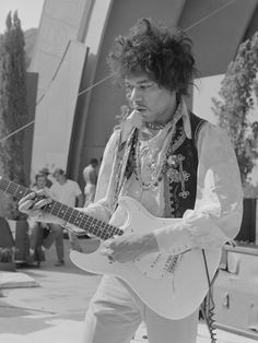 jimi hendrix on stage at the hollywood bowl