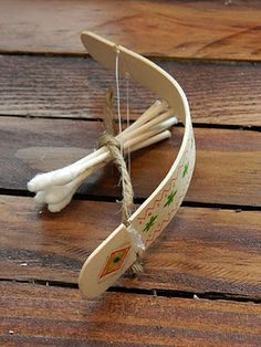Popsicle stick bow and arrow! Soak the stick in water for a few hours, bend, tie string into grooves, cut q-tips with a small groove and shoot!