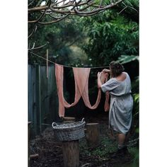 """Photography & Video on Instagram: """"Ceramicist, florist and natural dye artist Cindy @nest_and_nettle in her back garden on the Gold Coast, hanging material she had just dyed…"""" Back Gardens, Video Photography, Gold Coast, Nest, Natural, Outdoor Decor, Artist, How To Make, Instagram"""