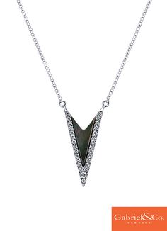 This is such a gorgeous 14k White Gold Diamond Black Mother Of Pearl Necklace by Gabriel & Co. We love this black mother of pearl stone surrounded by such stunning diamonds. This piece is the perfect piece for your winter holiday parties and the rest of your cozy winter!