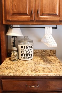 #LaundryOrganization #HangerHanger :: Laundry Room Organizing Ideas :: Towel rod to hang hangers