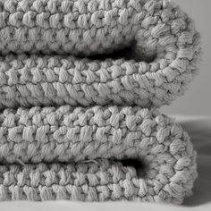 This looks so cosy.  Knot Throw; Knot is a unique hand knit throw produced by a collective in South America who are dedicated to improving the lives of women by sharing their hand-knit products with the global market.