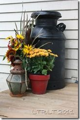 put one of my milk cans on our deck in the corner with flowers like this