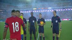 Apology accepted: Juan Zuniga is embraced by Brazil captain Neymar before the friendly mat...