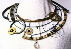 Necklace | Tory Hughes, Armillary,1992.  polymer, steel, glass, brass, silver, mustard seeds
