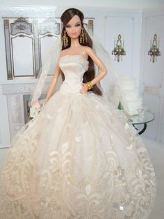 Barbie doll wearing a long  bridal gown