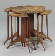 A NEST OF FIVE ROSEWOOD TABLES -  EUGENE GAILLARD, CIRCA 1913.