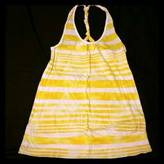 Racer-back tank top Striped yellow/white racer-back tank top. Lightweight/comfy. Cute knotted back. Gently worn. No holes, stains, etc. Tops Tank Tops