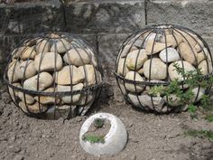 made from two garden hangers (the type with coir liners). Take the liners out, Make sure bigger hole is at bottom, before wiring them together. Push small stones into middle, with bigger stones to the outside,