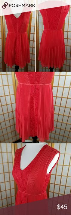 """Marciano red lace trim  pleated chiffon dress Marciano red lace trim pleated chiffon dress, sleeveless with v-neck. Side zipper. Fully lined. Excellent used condition.  Size 4 measures 16"""" across from armpit to armpit when laid flat 13"""" across the waist when laid flat with no stretch and is 32"""" long from back neckline to hem. Marciano Dresses Mini"""