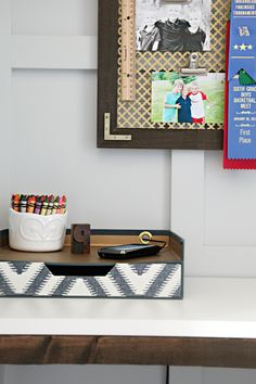 Stylish Phone Charger - Drill a hole and add a grommet on a desk organizer for the charging cord!